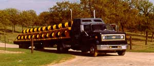 44 pipeline rollers on 45' flatbed trailer